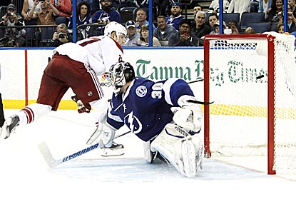 Phoenix's Radim Vrbata goes to his backhand to beat Tampa Bay's Ben Bishop for the only goal of the shootout.  (USATSI)
