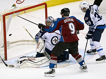 Matt Duchene puts the puck past Al Montoya, and improves Colorado's overtime record to 8-2.  (Getty Images)