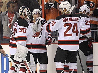 Martin Brodeur receives congratulations after earning the 50th victory against Philadelphia in his 21-season career.  (USATSI)