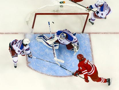 Elias Lindholm (bottom) watches his shot get past Rangers goaltender Henrik Lundqvist during the third period.  (USATSI)