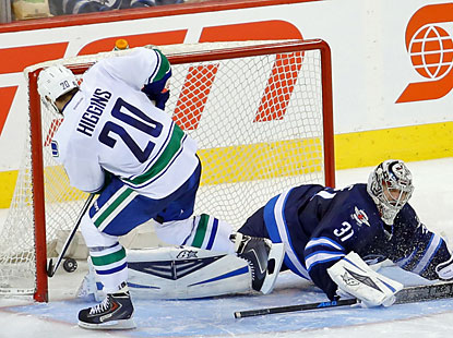 Chris Higgins scores the only goal in the shootout to help the Canucks survive a third-period collapse. (USATSI)