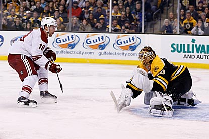 Boston's Tuukka Rask denies Phoenix's Shane Doan during the second period. Rask shuts out the Coyotes until the third period.  (USATSI)