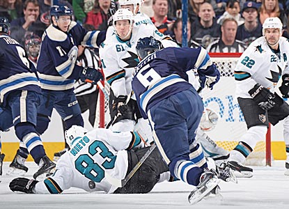 San Jose's Matt Nieto gets down to block a shot by Columbus' Nikita Nikitin during the second period.  (Getty Images)