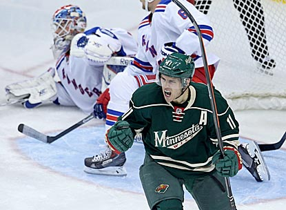 Zach Parise celebrates his goal against his former team, which puts Minnesota ahead to stay.  (USATSI)