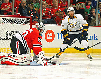 Nashville's Ryan Ellis scores in the third period against Blackhawks goalie Corey Crawford. (USATSI)