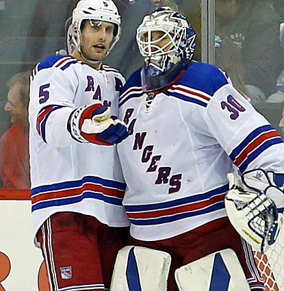 Henrik Lundqvist stops 30 shots against the Jets to tie the Rangers' record for career wins. (USATSI)