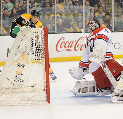 Milan Lucic has a wide-open net as he starts the scoring for Boston with a goal past Hurricanes goalie Cam Ward.  (USATSI)