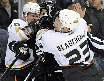 Robyn Regehr is shoved by Anaheim's Corey Perry and Francois Beauchemin. The Ducks win the skirmish and the game. (USATSI)