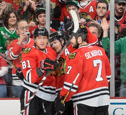 Marian Hossa (81) celebrates his goal in the third period with Duncan Keith and Brent Seabrook.  (Getty Images)