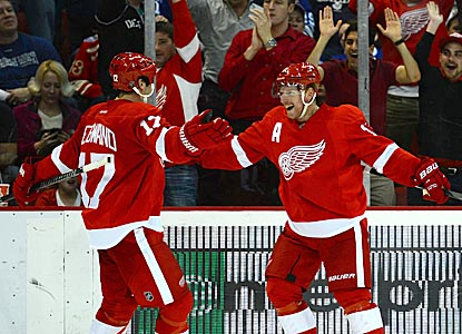 Daniel Alfredsson (left) and David Legwand celebrate after Alfredsson scores what turns out to be the winning goal for Detroit. (USATSI)