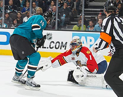 Joe Thornton leads San Jose's 54-shot barrage against Roberto Luongo, but the veteran goalie endures the ordeal and prevails. (Getty Images)