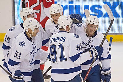 Ryan Callahan (right) draws a crowd after scoring a power-play goal that extends Tampa Bay's lead to 5-3.  (USATSI)