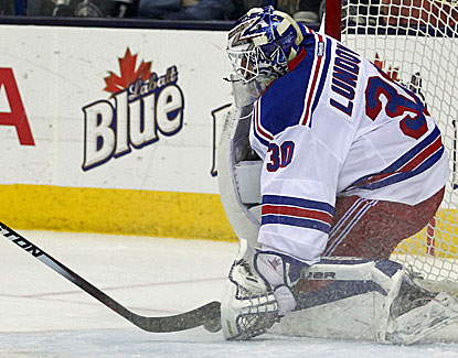 Henrik Lundqvist stops a shot on goal by the Blue Jackets, one of his 25 saves in the Rangers' victory. (USATSI)