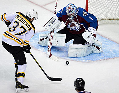 Patrice Bergeron shoots and scores against Avalanche goalie Semyon Varlamov, his 20th of the season. (USATSI)