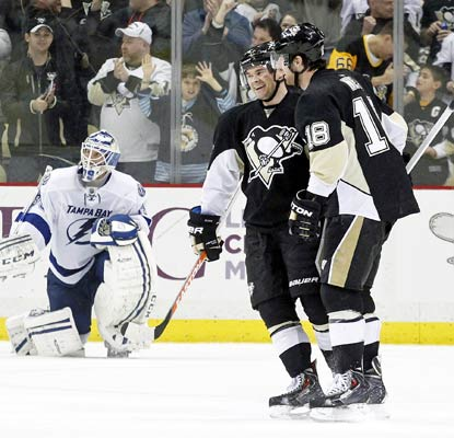 James Neal (18) celebrates his goal in overtime with Chris Kunitz and the Penguins end the Lightning's winning streak.  (USATSI)