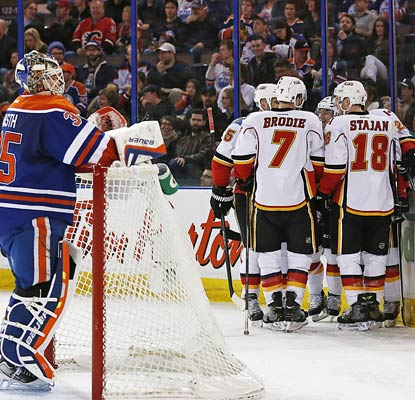 The Flames celebrate one of Curtis Glenncross' three goals in an offensive explosion against the Oilers.  (USATSI)