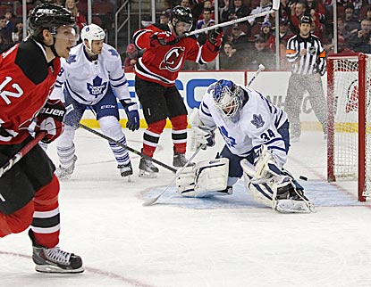 New Jersey's Damien Brunner (12) watches his shot get past Toronto goaltender James Reimer in the first period.  (USATSI)