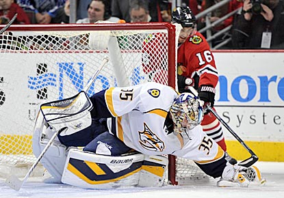 Pekka Rinne thwarts Marcus Kruger on a Chicago scoring chance in the third period en route to his first shutout of the season.  (USATSI)
