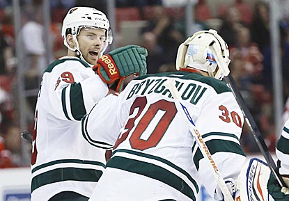 Nate Prosser and goalie Ilya Bryzgalov celebrate the Wild's victory, which keeps Minnesota safely above the playoff line.  (USATSI)