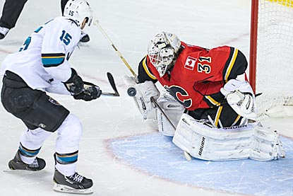 Calgary's Karri Ramo denies San Jose left wing James Sheppard in the shootout, during which Ramo stops all three Sharks tries.  (USATSI)