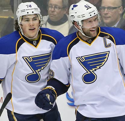 David Backes (right) scores three goals for the Blues, who pass the Bruins for most points in the NHL at 105.  (USATSI)