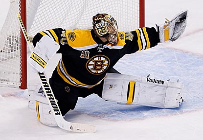 Tuukka Rask makes a glove save in the third period en route to earning his NHL-high seventh shutout of the season.  (USATSI)
