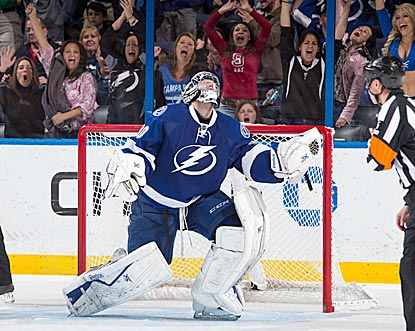 Ben Bishop exults after making the save that ends one of the longest shootout duels in NHL history.  (Getty Images)
