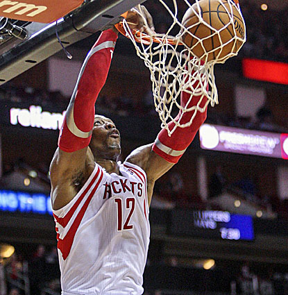 Dwight Howard contributes 17 points with 13 rebounds for the Rockets, including this slam dunk. (USATSI)