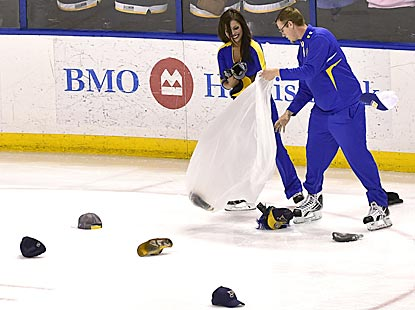 T.J. Oshie's third goal produces a flurry of hats in St. Louis, but the Blues ice crew doesn't seem to mind the extra work.  (USATSI)