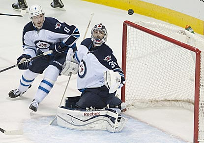 Winnipeg's Al Montoya, who makes 27 saves, watches the puck go over the net during the first period.  (USATSI)