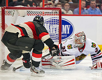 Ottawa's Milan Michalek gets the puck past Chicago goalie Antti Raanta in the Senators' 5-3 win. (USATSI)