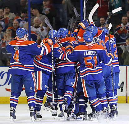 The Oilers celebrate after defenseman Andrew Ference scores the game-winning goal at 3:51 of overtime. (USATSI)
