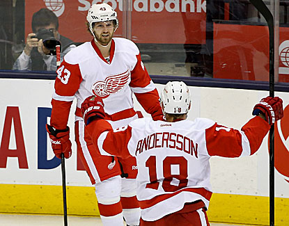 Darren Helm and Daniel Alfredsson celebrate the second of Helm's three goals in Detroit's win over Toronto. (USATSI)