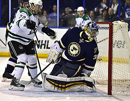 Colton Sceviour gets the puck past Blues goalie Ryan Miller for one of his two goals in the Stars' win over St. Louis. (USATSI)