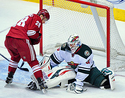 Ilya Bryzgalov makes the save for the Wild, who pull three points ahead of Phoenix in the playoff chase after their 3-1 win. (USATSI)
