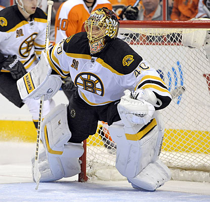 Tuukka Rask makes a career-high 49 saves while earning his 100th victory for the Bruins.  (USATSI)