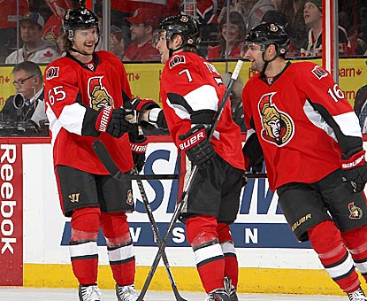 Ottawa's Kyle Turris (center) celebrates his third-period goal with Erik Karlsson (left) and Clarke MacArthur.  (Getty Images)