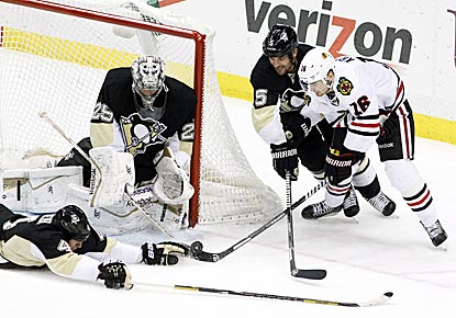 Pittsburgh's Rob Scuderi (left), goalie Marc-Andre Fleury and Deryk Engelland combine to stop Michal Handzus' wraparound try.  (USATSI)