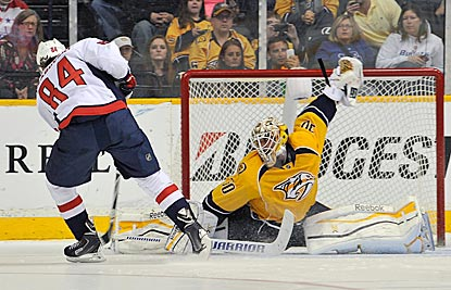Nashville's Carter Hutton goes way down to make a save on Washington's Mikhail Grabovski during the shootout.  (Getty Images)