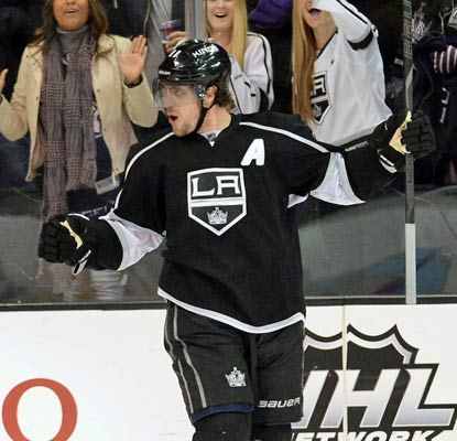 Anze Kopitar notches a power-play goal as the Kings lock up a spot in the postseason.  (USATSI)