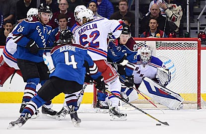 Colorado's Tyson Barrie prepares to shoot the puck past Henrik Lundqvist in the final minute of regulation.  (USATSI)