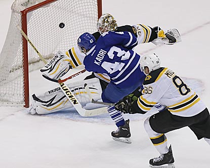 Nazem Kadri lifts a shot over Boston's Chad Johnson in overtime to keep Toronto in the hunt for a playoff berth.  (USATSI)