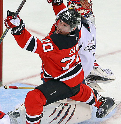 Ryan Carter celebrates scoring the tiebreaking goal with 4:54 remaining to lift the Devils over the Capitals. (USATSI)