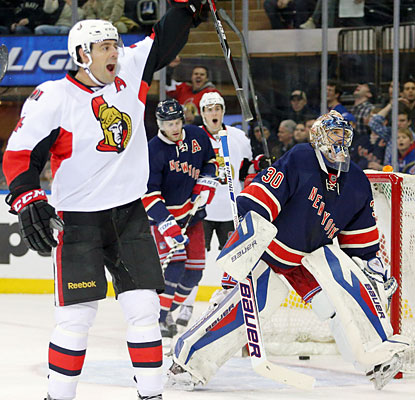 Senators defenseman Chris Phillips celebrates a goal by Mark Stone (not shown), who scores in the first period.  (USATSI)