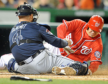 Braves catcher Ryan Doumit tags out the Nationals' Jose Lobaton following a fantastic throw by Atlanta's B.J. Upton. (USATSI)