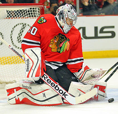 Corey Crawford stands tall after yielding the game's first goal, stopping 21 shots for his 31st victory of the season.  (USATSI)