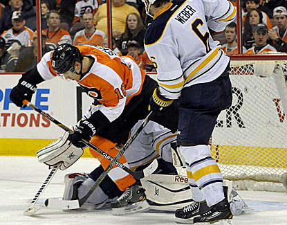 Brayden Schenn scores one of his two goals against the Sabres, a deflection of a Mark Streit slap shot. (USATSI)