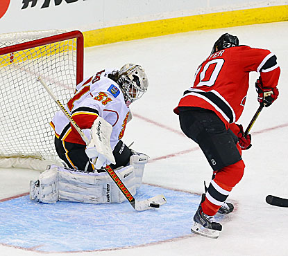 Calgary's Karri Ramo makes one of his 31 saves during the Flames' 1-0 win over the Devils. (USATSI)