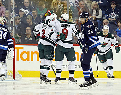 The Wild celebrate after Charlie Coyle (left) scores against the Jets. The goal ends up being the game-winner. (USATSI)