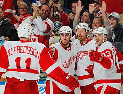 Brendan Smith (second left) celebrates his second-period goal with Daniel Alfredsson, Johan Franzen and Pavel Datsyuk. (Getty Images)